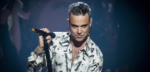 Zpěvák Robbie Williams.